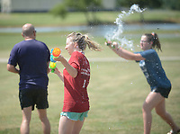 NWA Democrat-Gazette/ANDY SHUPE<br /> Wednesday, July 4, 2018, during the second 4th of July Water Balloon War organized by Project Red Friday at Ward Nail Park in Lowell. The organization works to raise awareness for military service members and their families by encouraging people to wear red on Fridays.