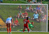 BOYDS, MD - May 26 2014: Erin McLeod of Houston saves Diana Matheson penalty kick during Washington Spirit v Houston Dash NWSL match at Maryland Sportsplex, in Boyds, Maryland. Spirit won 3-2.