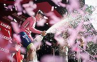 Simon Clarke (AUS/Orica-GreenEDGE) takes over the magnolia rosa from roommate Michael Matthews (AUS/Orica-GreenEDGE) and celebrates in full force<br />  <br /> 2015 Giro<br /> st4: Chiavari - La Spezia (150km)