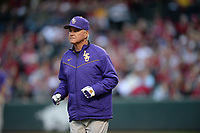 NWA Democrat-Gazette/ANDY SHUPE<br /> LSU coach Paul Mainieri heads to third to check on a player Friday, May 10, 2019, after an injury during the fourth inning at Baum-Walker Stadium in Fayetteville. Visit nwadg.com/photos to see more photographs from the game.