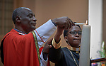 The Rev, Canon Gideon Byamugisha and the Rev, Jane Ng'an'ga light a candle during a July 23 interfaith prayer and memorial service in the Keizersgrachtkerk in Amsterdam, the Netherlands. Sponsored by the World Council of Churches-Ecumenical Advocacy Alliance, the service was held on the first day of the 2018 International AIDS Conference.