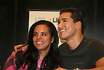 Bold and The Beautiful's Mario Lopez poses with a fan as he signs a new book Mud Tacos or Tacos de Lodo on October 16, 2009 at Lincoln Square Barnes & Noble, New York City, New York.
