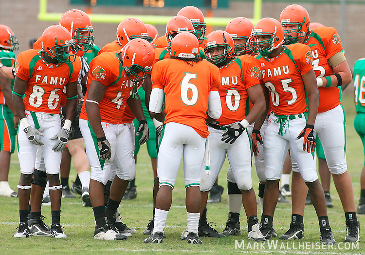 The FAMU Rattler offense huddles around quarterback Robert Love (6) during the Orange and Green spring football game at Bragg Memorial Stadium Saturday April 14, 2007.  (Mark Wallheiser/TallahasseeStock.com)