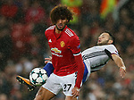 Marouane Fellaini of Manchester United (L) is tackles Renato Steffen of Basel during the Champions League Group A match at the Old Trafford Stadium, Manchester. Picture date: September 12th 2017. Picture credit should read: Andrew Yates/Sportimage