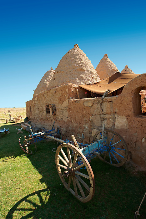 "Pictures of the beehive adobe buildings of Harran, south west Anatolia, Turkey.  Harran was a major ancient city in Upper Mesopotamia whose site is near the modern village of Altınbaşak, Turkey, 24 miles (44 kilometers) southeast of Şanlıurfa. The location is in a district of Şanlıurfa Province that is also named ""Harran"". Harran is famous for its traditional 'beehive' adobe houses, constructed entirely without wood. The design of these makes them cool inside. 33"
