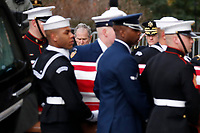Former president George W. Bush watches as the flag-draped casket of former President George H.W. Bush is carried by a joint services military honor guard into a State Funeral at the National Cathedral, Wednesday, Dec. 5, 2018, in Washington. <br /> Credit: Alex Brandon / Pool via CNP / MediaPunch