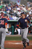 Houston Astros catcher Jason Castro (15) after he hit a home run against the Miami Marlins during a spring training game at the Roger Dean Complex in Jupiter, Florida on March 12, 2013. Houston defeated Miami 9-4. (Stacy Jo Grant/Four Seam Images)........