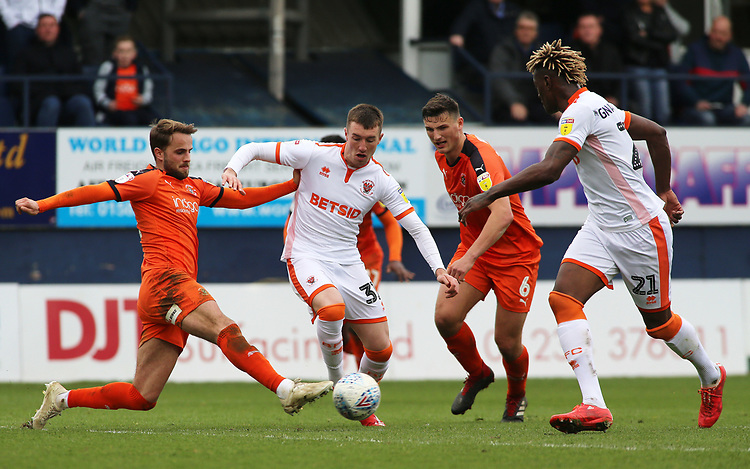 Blackpool's Chris Long battles his way through the Luton Town defence<br /> <br /> Photographer David Shipman/CameraSport<br /> <br /> The EFL Sky Bet League One - Luton Town v Blackpool - Saturday 6th April 2019 - Kenilworth Road - Luton<br /> <br /> World Copyright © 2019 CameraSport. All rights reserved. 43 Linden Ave. Countesthorpe. Leicester. England. LE8 5PG - Tel: +44 (0) 116 277 4147 - admin@camerasport.com - www.camerasport.com