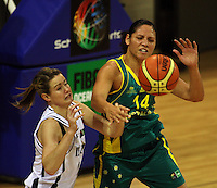 Tall Ferns forward Georgina Richards and Opals Rohanee Cox compete for the ball during the International women's basketball match between NZ Tall Ferns and Australian Opals at Te Rauparaha Stadium, Porirua, Wellington, New Zealand on Monday 31 August 2009. Photo: Dave Lintott / lintottphoto.co.nz
