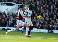 Pictured L-R: James Tomkins against Wilfried Bony of Swansea.  01 February 2014<br /> Re: Barclay's Premier League, West Ham United v Swansea City FC at Boleyn Ground, London.