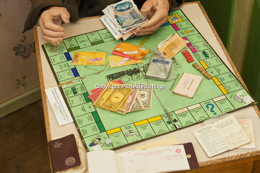 BNPS.co.uk (01202 558833)<br /> Pic: RachelAdams/BNPS<br /> <br /> A Monopoly set famously played by the Great Train Robbers using real money while lying low at a farm after there &pound;2.6 million heist has emerged 50 years after the infamous event.<br /> <br /> The tatty board game came to light after it was brought to the Antiques Roadshow for valuation, revealing the little-known story of its part in the 20th century's most notorious heist.<br /> <br /> It was discovered by police in a farmhouse hideout days after the brazen hold-up on a Royal Mail train in 1963.<br /> <br /> The train had been travelling from Glasgow to London but was set upon at Ledburn in Buckinghamshire by the gang, who had tampered with signals.<br /> <br /> The robbers stormed the train and took all but seven of 128 highly-prized sacks worth a total of &pound;2.6 million - the equivalent of nearly &pound;50 million nowadays.<br /> <br /> Following the robbery the gang, including ringleader Bruce Reynolds, Buster Edwards and Ronnie Biggs - retreated to a nearby farmhouse to avoid police.<br /> <br /> There they played the board game to pass the time and would use real money to buy 'property'.