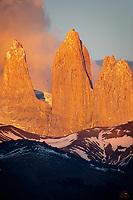 Golden morning light illuminates the Torres del Paine.  View from Lago Azul.