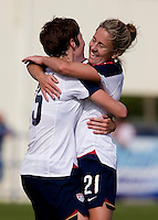 USWNT forward Megan Rapinoe (15) celbrates her goal with teammate (21) Kacey White during the last group stage game in the Algarve Cup.  The USWNT defeated Norway, 1-0, in Ferreiras, Portugal. Photo by Brad Smith/ isiphotos.com