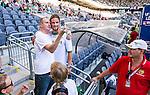 Stockholm 2014-07-20 Fotboll Superettan Hammarby IF - &Ouml;sters IF :  <br /> Hammarbys Linus Hallenius blir fotograferad av Hammarbysupporter innan matchen<br /> (Foto: Kenta J&ouml;nsson) Nyckelord:  Superettan Tele2 Arena Hammarby HIF Bajen &Ouml;ster &Ouml;IF portr&auml;tt portrait glad gl&auml;dje lycka leende ler le supporter fans publik supporters