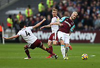 West Ham United's Marko Arnautovic holds off Burnley's Jack Cork and Ben Mee<br /> <br /> Photographer Rob Newell/CameraSport<br /> <br /> The Premier League - West Ham United v Burnley - Saturday 10th March 2018 - London Stadium - London<br /> <br /> World Copyright &copy; 2018 CameraSport. All rights reserved. 43 Linden Ave. Countesthorpe. Leicester. England. LE8 5PG - Tel: +44 (0) 116 277 4147 - admin@camerasport.com - www.camerasport.com