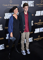 Carrie-Anne Moss &amp; Owen Roy at the premiere of &quot;John Wick Chapter Two&quot; at the Arclight Theatre, Hollywood. <br /> Los Angeles, USA 30th January  2017<br /> Picture: Paul Smith/Featureflash/SilverHub 0208 004 5359 sales@silverhubmedia.com
