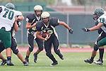 Torrance, CA 10/05/11 - Issac Kuo (Peninsula #28) and Shane Scott (Peninsula #18) in action during the Peninsula vs South Torrance Junior Varsity football game.