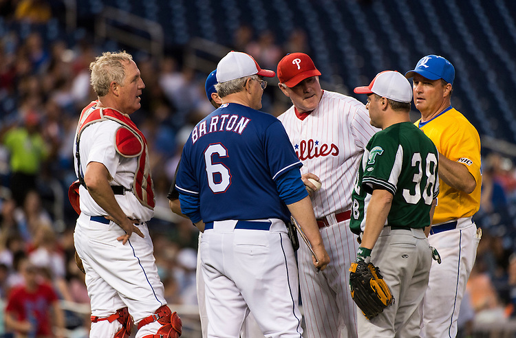UNITED STATES - JUNE 13: GOP coach Rep. Joe Barton, R-Texas, has a word with his players on the pitching mound during the 52nd annual Congressional Baseball Game at national Stadium in Washington on Thursday, June 13, 2013. (Photo By Bill Clark/CQ Roll Call)