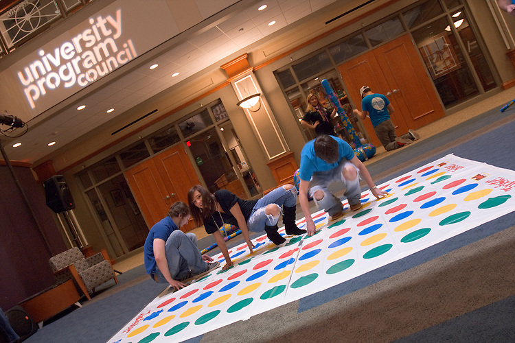Chris Clary (L), Taylor Williams, and J.J Barley (R) play twister during UPC's SibFest