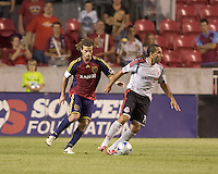 Toronto FC midfielder Dwayne De Rosario (14) dribbles as Real Salt Lake midfielder Kyle Beckerman (5) defends. Salt Lake Real defeated Toronto FC, 3-0, at Rio Tinto Stadium on June 27, 2009.