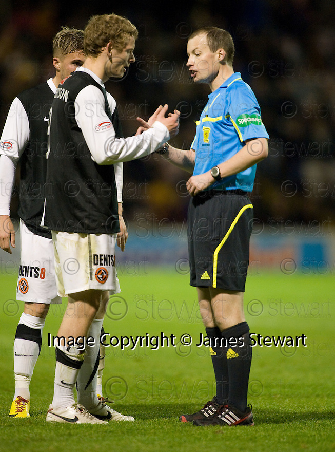 26/10/2010   Copyright  Pic : James Stewart.sct_jsp023_motherwell_v_dunde_utd  .::  REFEREE WILLIE CLLUM STAMPS HIS AUTHORITY ON THE GAME ::.James Stewart Photography 19 Carronlea Drive, Falkirk. FK2 8DN      Vat Reg No. 607 6932 25.Telephone      : +44 (0)1324 570291 .Mobile              : +44 (0)7721 416997.E-mail  :  jim@jspa.co.uk.If you require further information then contact Jim Stewart on any of the numbers above.........