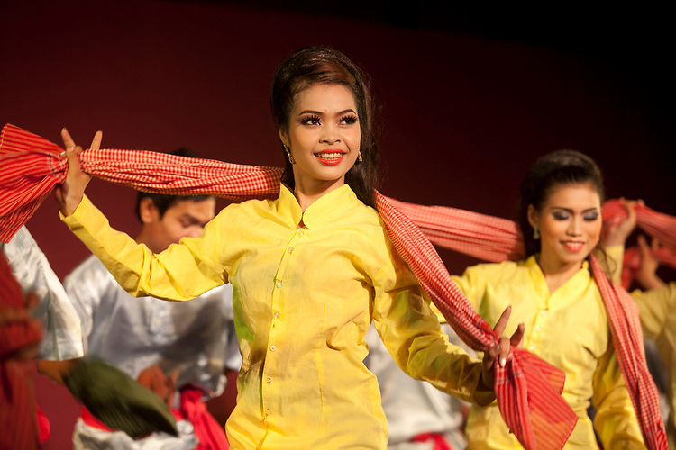 Performance of  traditional Cambodian dance by members of the Cambodian Living Arts organization at the National Museum in Phnom Penh, Cambodia. <br /> <br /> Photos &copy; Dennis Drenner 2013.