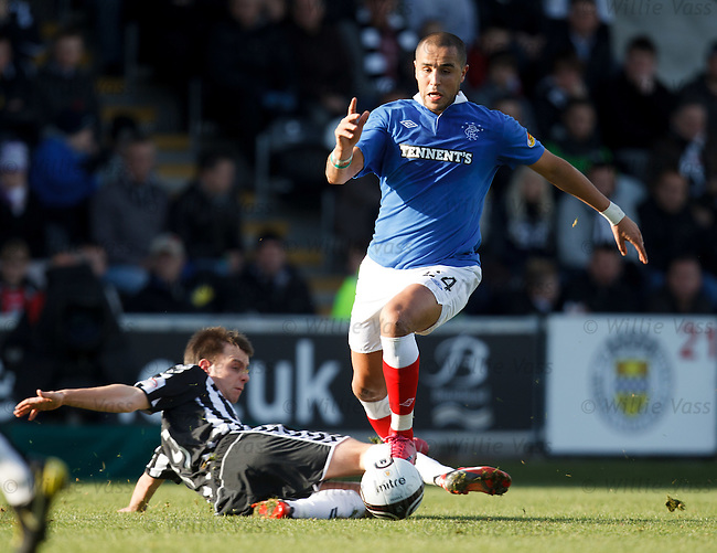 Madjid Bougherra surges forwards and over the challence of Paul McGowan