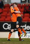 Ryan Gauld celebrates his goal for Dundee Utd with Jon Daly