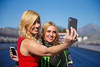 Feb 7, 2018; Pomona, CA, USA; NHRA top fuel driver Brittany Force (right) poses for a portrait with sister Courtney Force during media day at Auto Club Raceway at Pomona. Mandatory Credit: Mark J. Rebilas-USA TODAY Sports