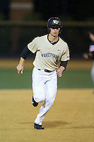 Stuart Fairchild (4) of the Wake Forest Demon Deacons hustles towards third base against the Davidson Wildcats at David F. Couch Ballpark on February 28, 2017 in Winston-Salem, North Carolina.  The Demon Deacons defeated the Wildcats 13-5.  (Brian Westerholt/Four Seam Images)