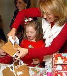 Audry Garner,4, reacts as her mother Holly helps her build a gingerbread house at the fourth annual Home Sweet Home Gingerbread Bash presented by BBVA Compass benefitting the Children's Museum  Saturday Dec. 05,2009. (Dave Rossman/For the Chronicle)