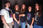 Various portrait sessions & live photographs of the rock band, Obituary