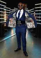 LAS VEGAS - NOVEMBER 23:  Lennox Lewis wears a custom suit displaying all his opponents on the FOX Sports PBC Pay-Per-View Fight Night at the MGM Grand Garden Arena on November 23, 2019 in Las Vegas, Nevada. (Photo by Frank Micelotta/Fox Sports/PictureGroup)