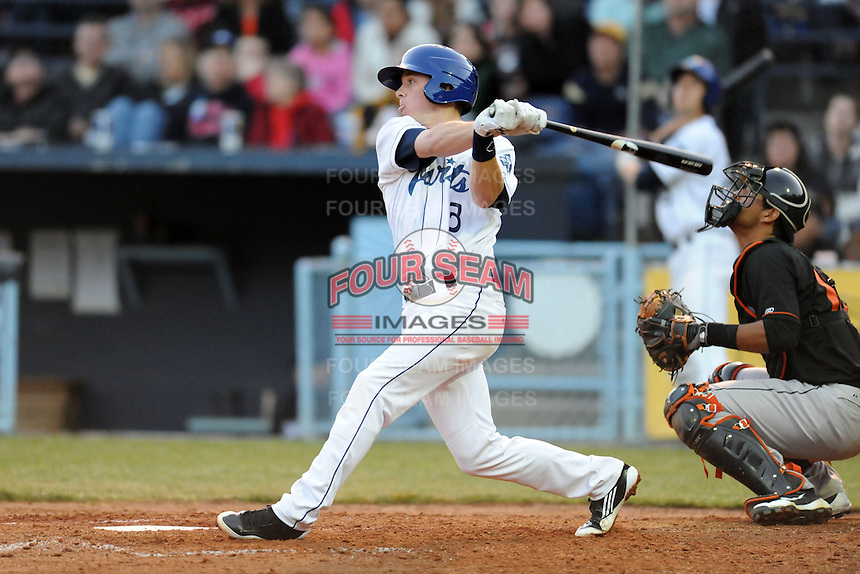 Asheville Tourists shortstop Trevor Story #3 swings at a pitch during a game between the Delmarva Shorebirds and the Asheville Tourists at McCormick Field, Asheville, North Carolina April 6, 2012. The Shorebirds won the game 7-2  (Tony Farlow/Four Seam Images)..