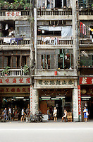 Hong Kong: Storefronts and apartments above. Photo '81.