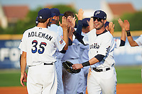 Pensacola Blue Wahoos outfielder Jesse Winker (23) high fives Timothy Adleman (35) while leading the celebratory line after the second game of a double header against the Biloxi Shuckers on April 26, 2015 at Pensacola Bayfront Stadium in Pensacola, Florida.  Pensacola defeated Biloxi 2-1.  (Mike Janes/Four Seam Images)