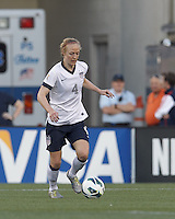 USWNT defender Becky Sauerbrunn  (4) dribbles. In an international friendly, the U.S. Women's National Team (USWNT) (white/blue) defeated Korea Republic (South Korea) (red/blue), 4-1, at Gillette Stadium on June 15, 2013.