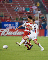 FC Dallas midfielder Pablo Ricchetti (6) and New England Revolution midfielder Steve Ralston (14) battle for the ball.  New England Revolution defeated FC Dallas 3-2 to capture the 2007 Lamar Hunt U.S. Open Cup at Pizza Hut Park in Frisco, TX on October 3, 2007.