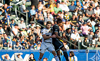 CARSON, CA - SEPTEMBER 29: Dave Romney #4 of the Los Angeles Galaxy goes head to head with Theo Bair #50 of the Vancouver Whitecaps during a game between Vancouver Whitecaps and Los Angeles Galaxy at Dignity Health Sports Park on September 29, 2019 in Carson, California.