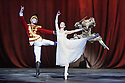 London, UK. 13.12.2016. English National Ballet presents NUTCRACKER, at the London Coliseum. Choreography by Wayne Eagling, based on a concept by Toer van Schayk and Wayne Eagling, music by Pyotr Ilyich Tchaikovsky, design by Peter Farmer, lighting by David Richardson. Picture shows: James Forbat (Nutcracker), Alina Cojocaru (Clara), James Streeter (Mouse King). Photograph © Jane Hobson.,