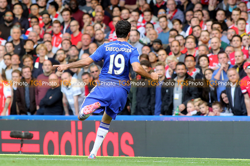 No response from the Arsenal fans as Diego Costa celebrates scoring Chelsea's second goal - Chelsea vs Arsenal - Barclays Premier League Football at Stamford Bridge, London - 05/10/14 - MANDATORY CREDIT: Paul Dennis/TGSPHOTO - Self billing applies where appropriate - contact@tgsphoto.co.uk - NO UNPAID USE