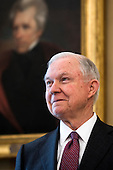 Attorney General Jeff Sessions listens to U.S. President Donald J. Trump speak before Vice President Mike Pence swore Sessions in as the next attorney general in the Oval Office of the White House in Washington, DC, USA, 09 February 2017. On 08 February, after a contentious battle on party lines, the Senate voted to confirm Sessions as attorney general.<br /> Credit: Jim LoScalzo / Pool via CNP