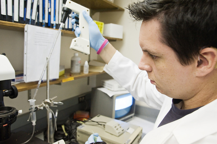 Graduate Student Matt Wood works on an experiment in Dr. Burdick's lab on October 19, 2009.