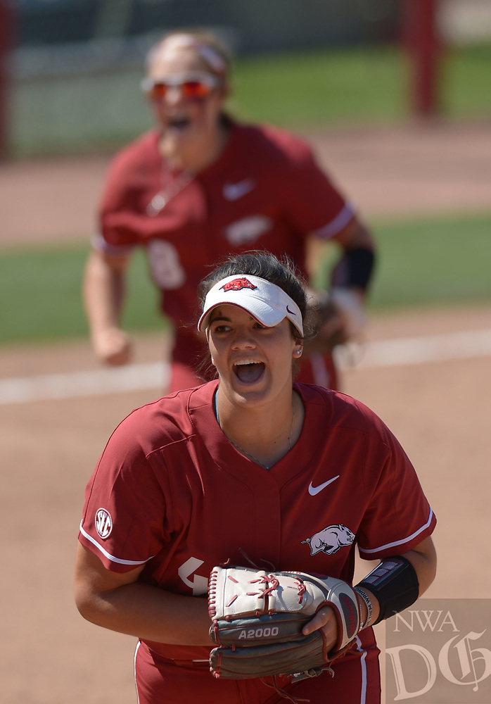 NWA Democrat-Gazette/ANDY SHUPE<br />Arkansas starter Mary Haff (bottom) and third baseman Autumn Buczek celebrate the final out Saturday, May 19, 2018, during the seventh inning against Wichita State at Bogle Park during the NCAA Fayetteville Softball Regional on the university campus in Fayetteville. Visit nwadg.com/photos to see more photographs from the game.