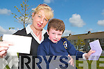 PAST ITS DEADLINE: Anne Walsh with her six year old son Donald who received a letter from his friend on Tuesday, three months late. .