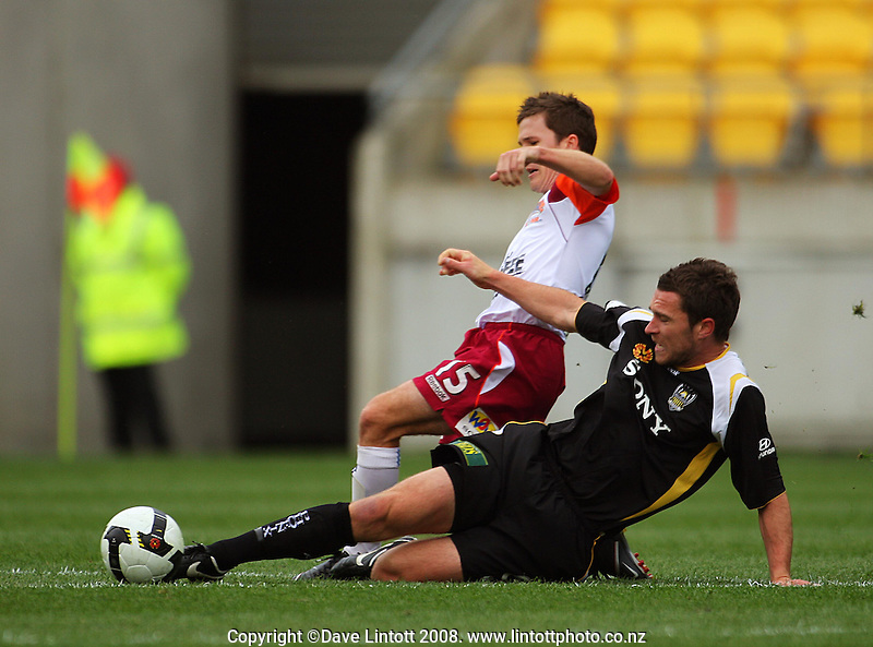 Tim Brown tackles Matthew McKay during the A-League football match between the Wellington Phoenix and Queensland Roar at Westpac Stadium, Wellington. Sunday, 26 October 2008. Photo: Dave Lintott / lintottphoto.co.nz