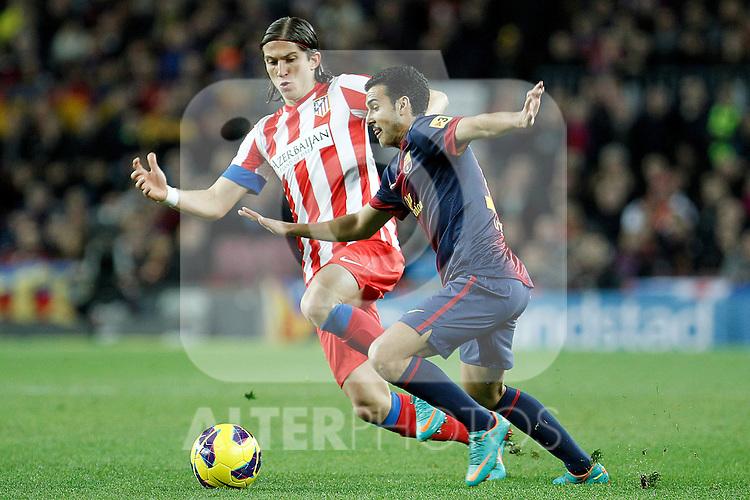 FC Barcelona's Pedro Rodriguez (r) and Atletico de Madrid's Filipe Luis during La Liga match.December 16,2012. (ALTERPHOTOS/Acero)