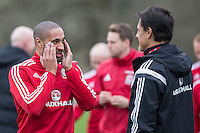 Team captain Ashley Williams and manager Chris Coleman enjoy a joke during Wales national team training ahead of the International Friendly match and Euro 2016 warm up match against Northern Ireland at Vale Resort, Hensol, Wales on 22 March 2016. Photo by Mark  Hawkins / PRiME Media Images.