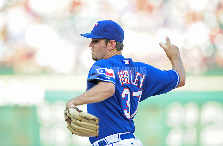 Jun. 18, 2008; Arlington, TX, USA; Texas Rangers pitcher Eric Hurley pitches against the Atlanta Braves at the Rangers Ballpark. Mandatory Credit: Mark J. Rebilas-