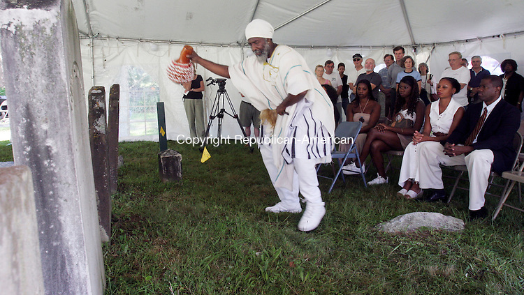 EAST HADDAM, CT-24July 2006-072406TK03- Abishai Ben Reuben Bey of Sounds of Africa peorlmed a Libation Ceremony over the grave of 18th centurey slave Venture Smith. Tom Kabelka Republican-American (Abishai Ben Reuben Bey)